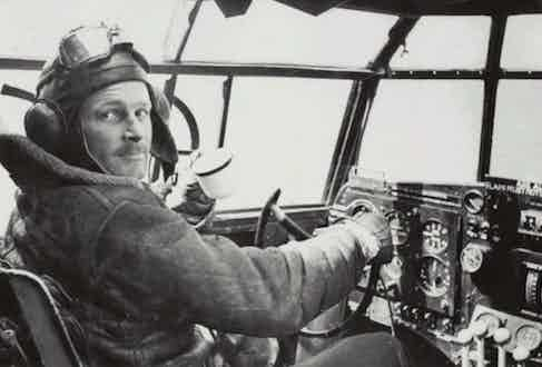 American aviator Leslie Irvin in an aeroplane cockpit, 1940. He is predominantly known for designing the iconic RAF sheepskin flying jacket in the early 1930s, a jacket that would go on to later become synonymous with his name.