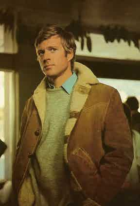 Robert Redford dons a tan suede and shearling jacket as Olympic skier David Chappellet in Downhill Racer, 1969.