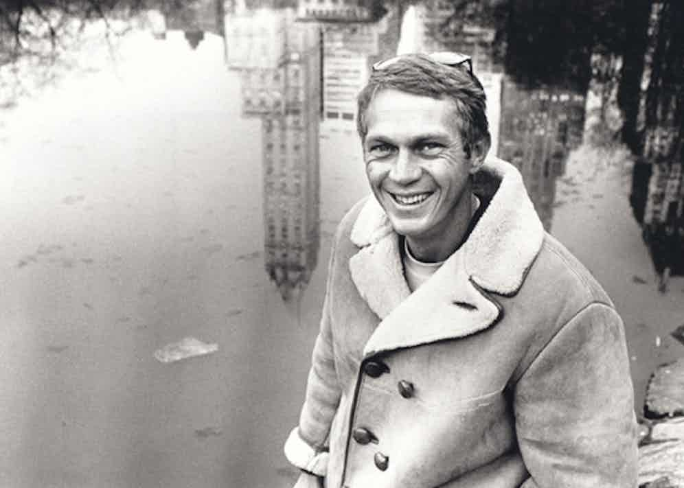 Steve McQueen wears a double-breasted suede shearling coat in Central Park, New York City, 1961.