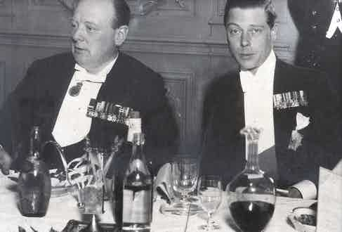 Surrounded by carafes of wine, Churchill dines with Edward VIII at the Savoy in 1930.