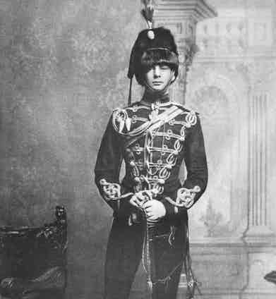 Standing proud in full uniform when serving for the 4th Hussars, a light cavalry regiment, 1895.