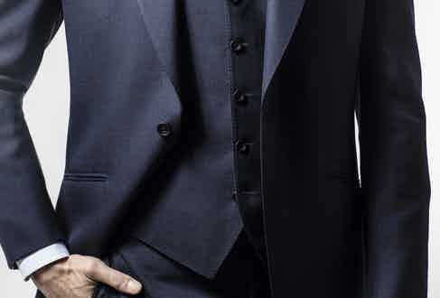 The cloth is a lighter, more contemporary Tonik compared to the original by Dormeuil.