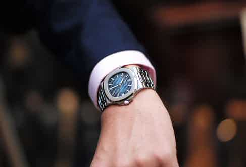 Glasgow's Nautilus displaying its vibrant blue dial.