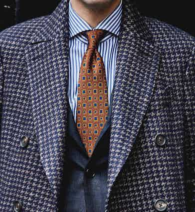 Lardini's double-breasted houndstooth overcoat worn with a 100Hands striped shirt, both of which will be at the pop-up.