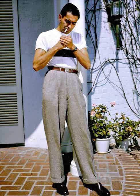 Tyrone Power playing with silhouettes in the 1940s. His slim-fitting knitted top is countered with billowing, wide-legged trousers with chunky turn-ups.