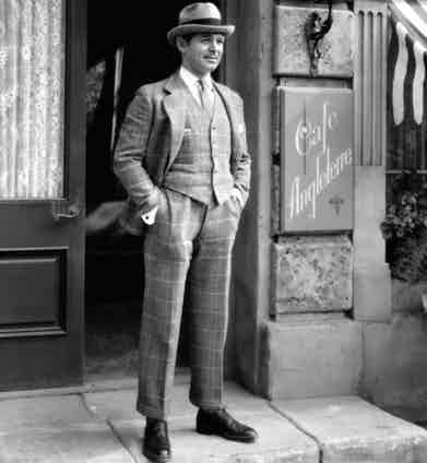 Whilst it looks relatively slim compared to the rest of the pictures in this article, Clark Gable's suit here boasts an elegant silhouette that's neither too full or too svelte. Note also the hem of the trousers, which sit just above the shoes meaning the wide cut of the legs hang effortlessly. He's pictured here in the late 1940s.