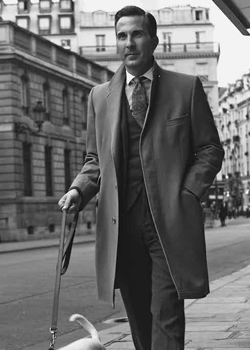 The author wears a covert coat over a three-piece wool suit.