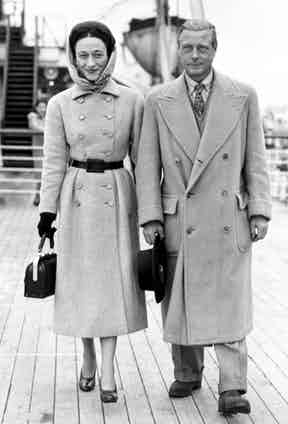 The Duke of Windsor wears a camel hair, double-breasted polo coat with a low-buttoning closure and large patched pockets, circa 1946.