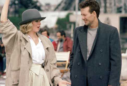 Mickey Rourke demonstrates a less formal way to wear a DB overcoat by layering it over a tonal knit. Here, he's shot with Kim Basinger in Nine ½ Weeks, 1986. Photograph by AF archive/Alamy.