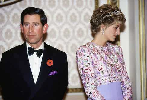 Prince Charles wears black tie brightened with a colourful pocket square with Princess Diana during a royal visit to South Korea, 2005.