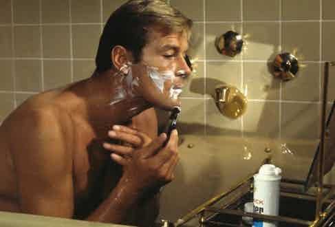 James Bond was always clean shaven as seen here by Roger Moore in Live and Let Die, 1973.