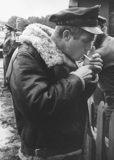 Steve McQueen wears the military legend B-3 sheepskin bomber jacket during filming of War Lover, 1961.