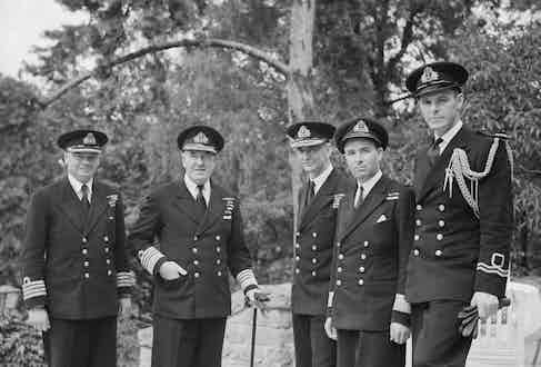 The uniform for British naval officers during World War Two included the double-breasted blazer with brass buttons as worn by the officers here in Berlin, 1945.