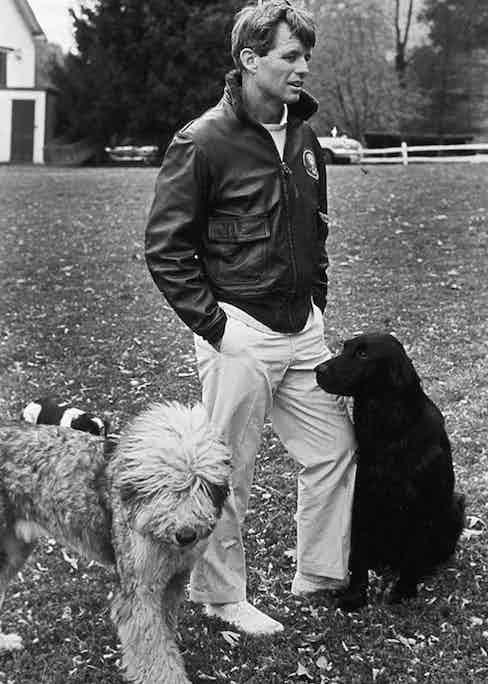 Robert F. Kennedy wears a leather flight jacket with a fur collar, circa 1957.