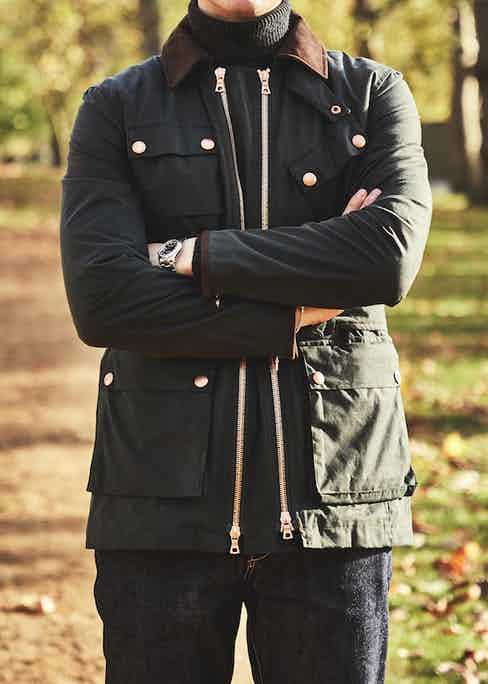 Private White V.C.'s twin track coat comes in two of the most versatile shades: navy blue and dark olive green.