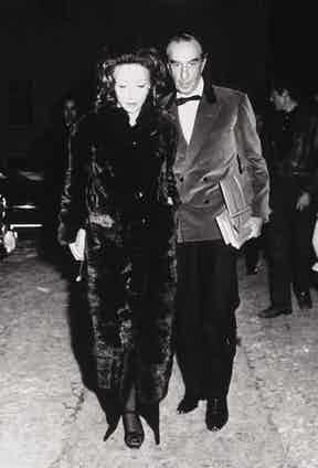 Italian fashion designer Emilio Pucci wears a velvet double-breasted dinner jacket with his wife, 1970. Photograph by Roland School/Pix Inc./Time Life Pictures/Getty Images.