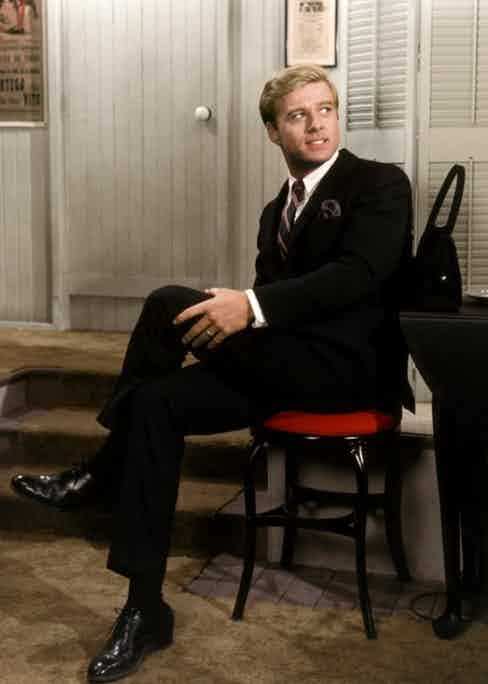 Robert Redford wears a black suit, white shirt and black Oxfords in Barefoot In The Park, 1967.