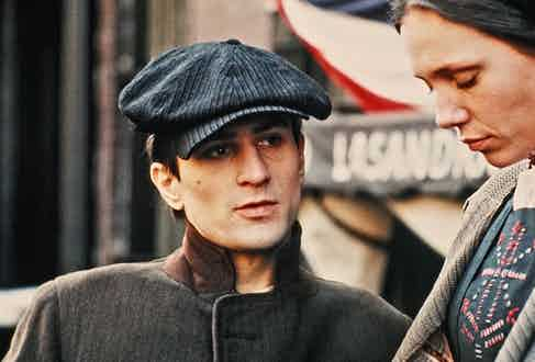 Robert De Niro's ensemble has subtle stripes throughout, from his cap to his coat in The Godfather Part II, 1974.