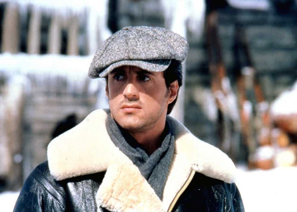 Sylvester Stallone tackles the elements in Rocky IV, in a hefty shearling coat and peaked cap.