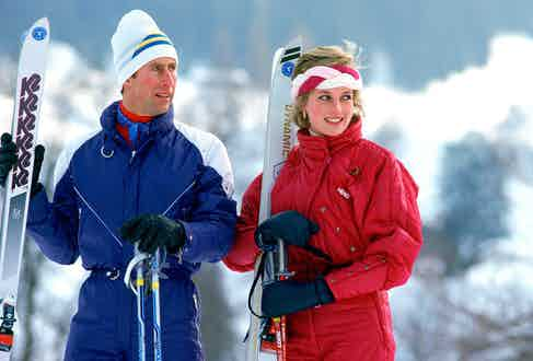 Prince Charles and Princess Diana are testament to the fact that colour can work on the slopes. Here they both don bright jumpsuits with equally bright roll necks while enjoying a holiday in Klosters, Switzerland, 1989.