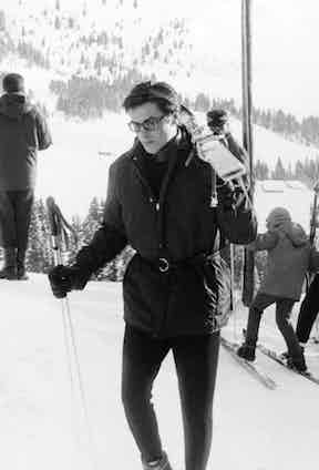 Alain Delon transferred his usual elegance and sophistication to the slopes in a belted ski-jacket and long johns, accessorised with a neck scarf and glasses, in Megeve, France, 1963.