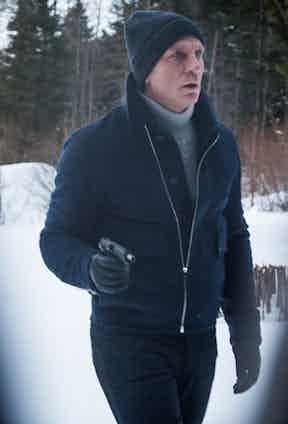 Daniel Craig's ski attire as 007 in Spectre, 2015, is the ultimate inspiration for a more modern and professional option with dark, slim-fitted jacket and trousers and a coordinating woollen hat.