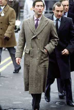 Prince Charles dons a tweed overcoat with a double-breasted closure while visiting Carlisle, 1986.