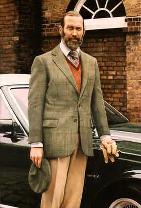Prince Michael of Kent is equally stylish and warm by pairing a tweed jacket with a woollen vest underneath and accessorised with a matching tweed cap in a portrait by Richard Stone, 1990.