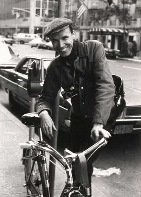 A young Bill Cunningham in a chore jacket and baker boy hat.