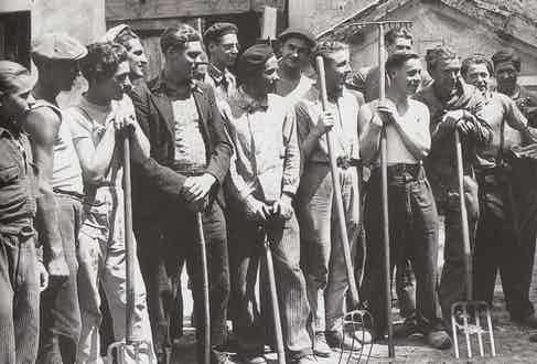A group of young men wearing traditional workwear.
