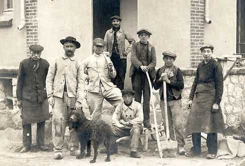 Labourers in well-worn and faded chore jackets.