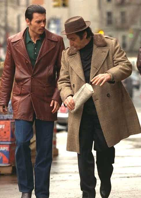 Al Pacino wears a glen check double-breasted pea coat with a contrasting fur collar with Johnny Depp in Donnie Brasco, 1997.