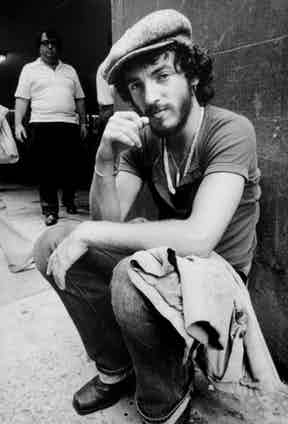 Bruce Springsteen brings a little rock and roll to the usually countrified associations of the peaked cap. Shot by Barbara Pyle circa 1974.