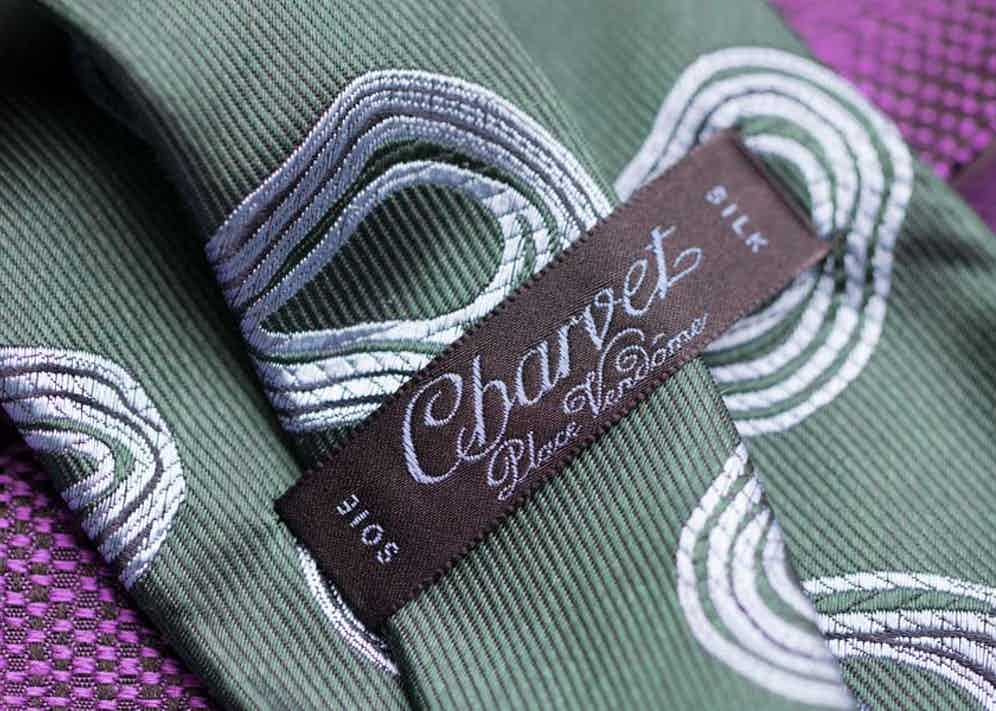Each tie is finished with the brand's signature.