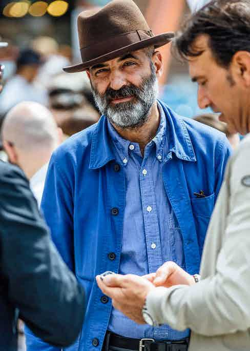 In Florence, a man wears a blue chore coat with a chambray Oxford shirt. Photograph by Jamie Ferguson.