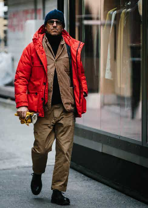 Having gone from an essential item for explorers and adventurers, you only have to be braving the cold in Florence (like this gentleman) to pull off a puffer now. Photo by Jamie Ferguson.