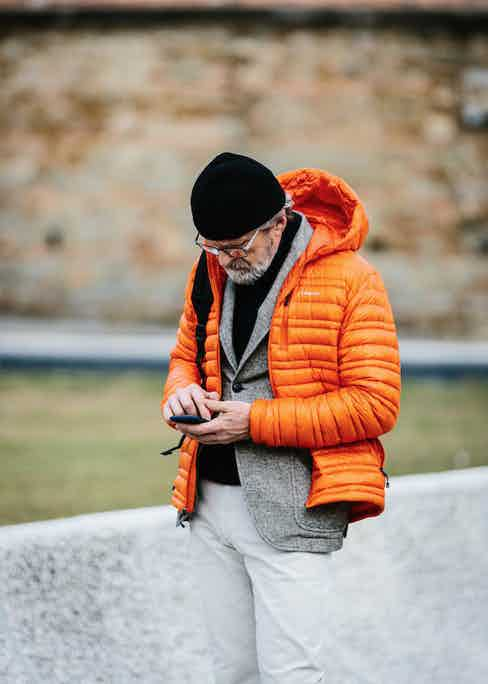 Layered over tailoring in a bold colour such as crimson or orange warms up an otherwise monochrome outfit. Photo by Jamie Ferguson.