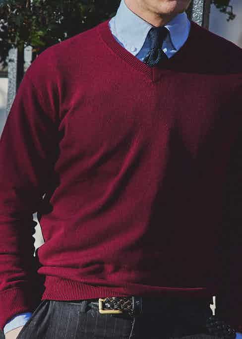 The V-neck cashmere jumper in maroon works well as a middle layer, here paired with a button-down shirt and knitted tie. Photograph by James Munro.
