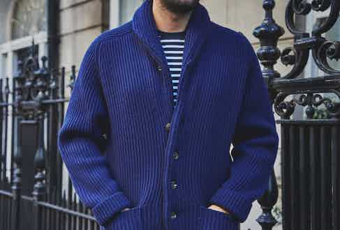 Made from 4-ply cashmere, the shawl collar cardigan is a stunning piece, featuring raglan shoulders, a six button front, twin patch pockets and a buttoned collar. Photograph by James Munro.