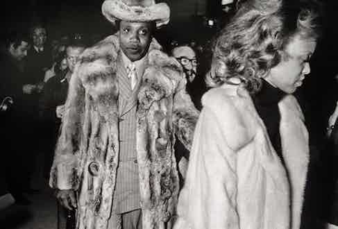 The real Frank Lucas wearing the infamous chinchilla fur coat to the 'Fight of the Century', 1971.