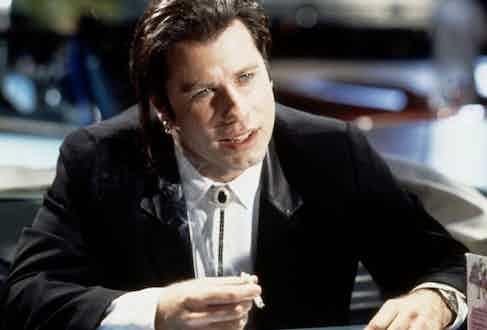 John Travolta wears a black stone bolo tie as Vincent Vega in Pulp Fiction, 1994.
