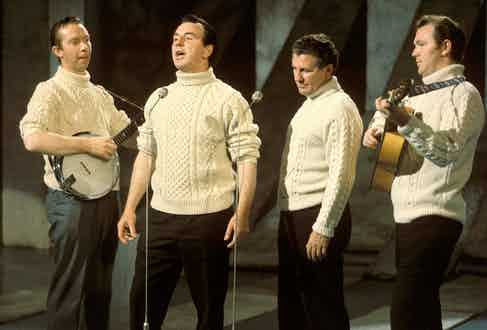 Irish folk band The Clancy Brothers had a significant impact on the appeal of the cable knit. Pictured here performing on US Television, 1961. Photo by David Redfern/Redferns/Getty.
