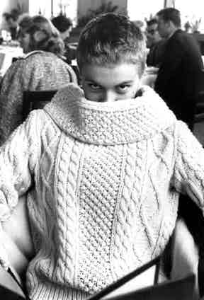 Jean Seberg adds French sophistication to the traditional Aran sweater with an oversized turtleneck during filming of Breathless, 1960.