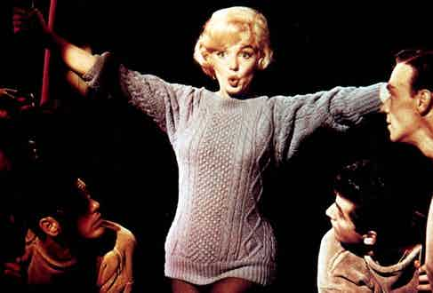 Marilyn Monroe gives the oversized cable knit sex appeal in Let's Make Love, 1960.