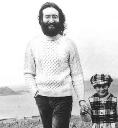 John Lennon opts for a classic woollen cable knit with short wrist cuffs and a high neck while on holiday in Scotland, 1969.