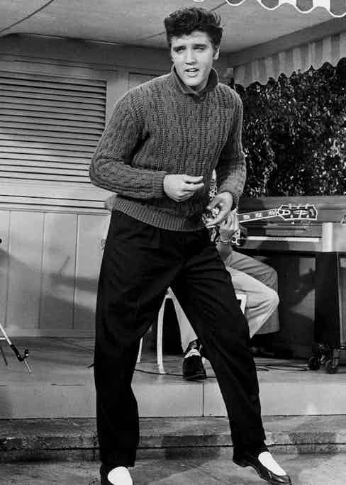 Elvis sported a cable knit funnel neck jumper for his performance in Jailhouse Rock (1957), which almost certainly brought the pattern to the forefront of popular style.