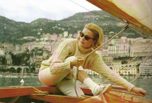 Grace Kelly gives the pattern a sporty yet classy edge as she dons a white cable turtleneck for sailing in Monaco.