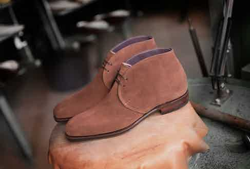 Carmina's elegant chukka boots sit beautifully beneath tailored trousers and formalwear, and are available to shop on TheRake.com.