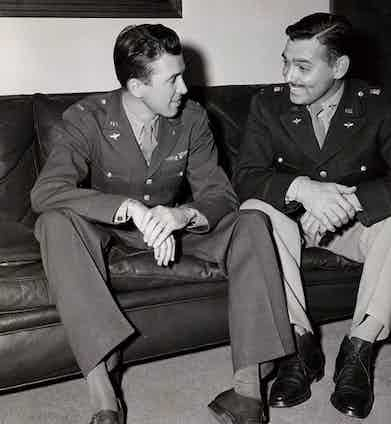 James Stewart and Clark Gable in uniform during their World War II military service. Gable (right) wears leather chukka boots with two lace holes and a rubber sole.