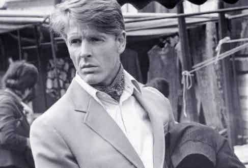 Edward Fox wears his cravat neatly tucked into a white shirt beneath a wool blazer in The Day of the Jackal, 1973.